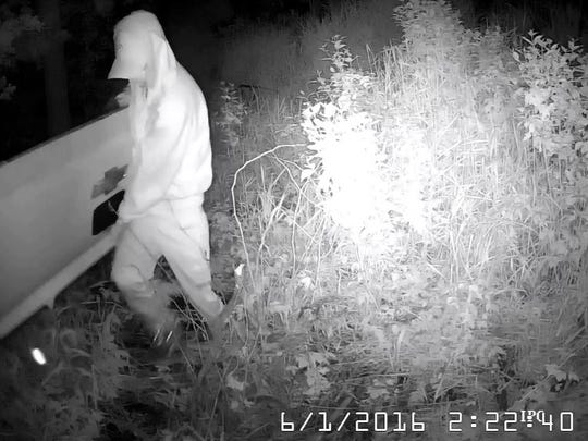 A camera captured several still images of suspects stealing tailgates.