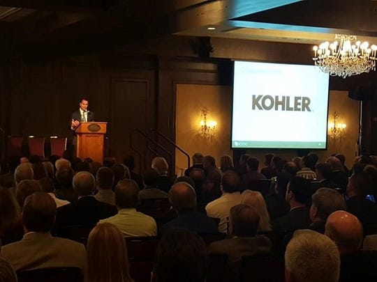 Kohler Co. President and CEO David Kohler accepts the Economic Driver of the Year Award Wednesday night the American Club in Kohler during the SCEDC's annual meeting.