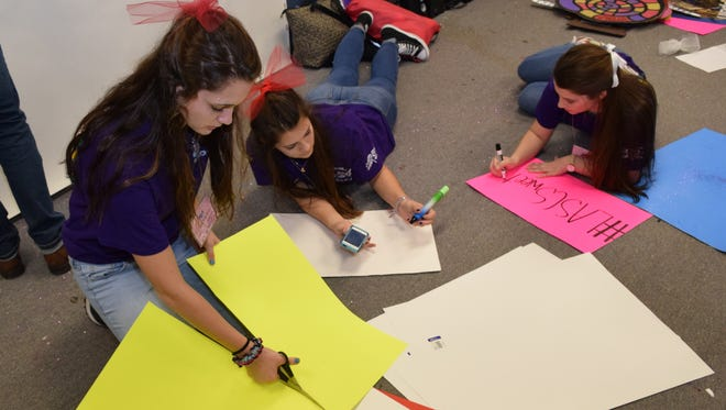Pineville High School student council members are shown making signs in preparation for the Louisiana Association of Student Councils convention.