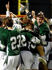Delbarton celebrates its Morris County Tournament boys lacrosse title May 8, 2018. Mt. Olive, NJ