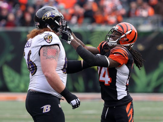 Jan 3, 2016; Cincinnati, OH, USA; Baltimore Ravens center Ryan Jensen (66) scrums with Cincinnati Bengals cornerback Adam Jones (24) in the first half at Paul Brown Stadium. The bengals won 24-16. Mandatory Credit: Aaron Doster-USA TODAY Sports