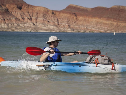 Marshall Josey demonstrates the use of proper safety equipment and technique while fishing from a kayak at Quail Creek Reservoir on Wednesday, June 24, 2015.