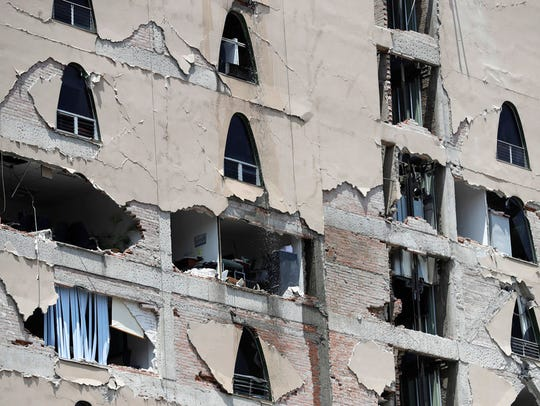 Remains of a damaged building stands after an earthquake
