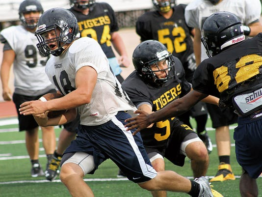 Hunter Graham rushes past defenders during practice Wednesday afternoon at Tiger Stadium.