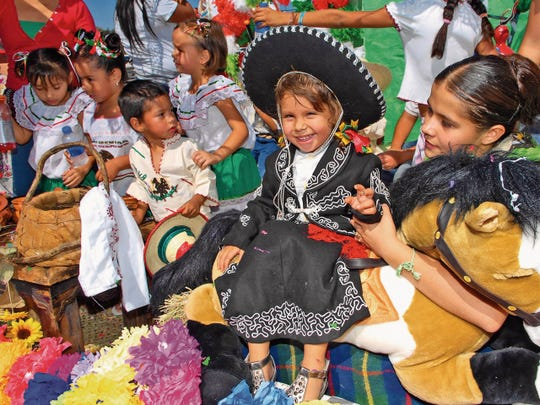 Sun-News file photo   Yailet Flores Rodriguez, 2, smiles while riding a float during the Diez y Seis de Septiembre celebration in Mesilla in this file photo, This year's parade begins at 11 a.m. Saturday from Calle de Mercado to Four Points Gin.