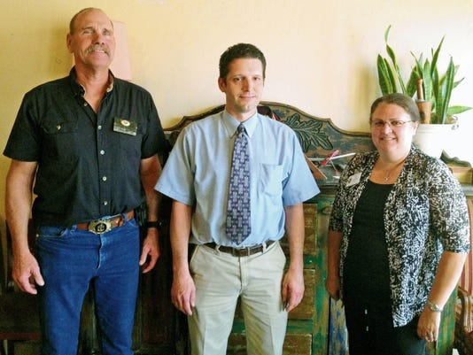 Kiwanis Club President Craig Pfeifer, left, and District Lt. Governor Lori Ann Bonomo, right, thanked Derek Ratcliff, manager of the Silver City Walgreens, on Tuesday for his store's support of the club's Community Easter Egg Hunt. Randal Seyler - Sun-News