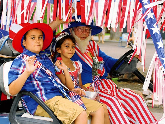 Glenn Fenwick has been Deming's resident Uncle Sam. The octogenarian dresses each Fourth of July and carries a couple of young passengers in his decorated golf cart in the parade.