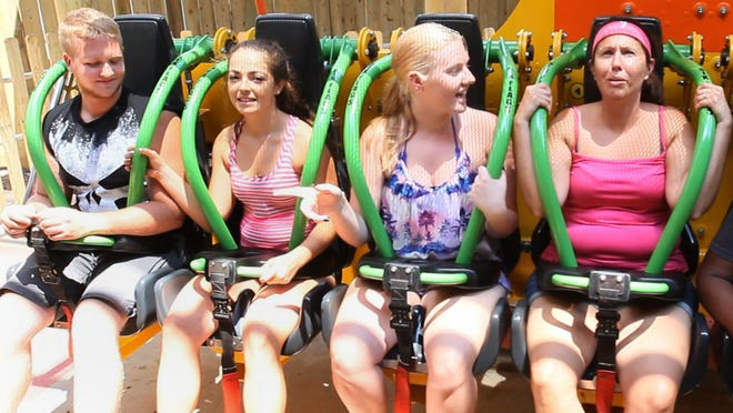 Riders are strapped in July 11, 2014, for the 415-foot descent of Zumanjaro: Drop of Doom at Six Flags Great Adventure in Jackson, N.J.