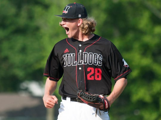 Haddonfield pitcher Dylan Heine celebrates during a game last season. Heine earned the victory during a season-opening win over Haddon Heights on Thursday.