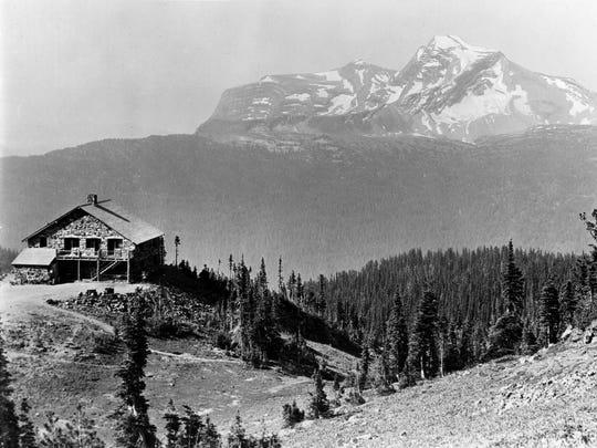 Granite Park Chalet is shown here with Heavens Peak