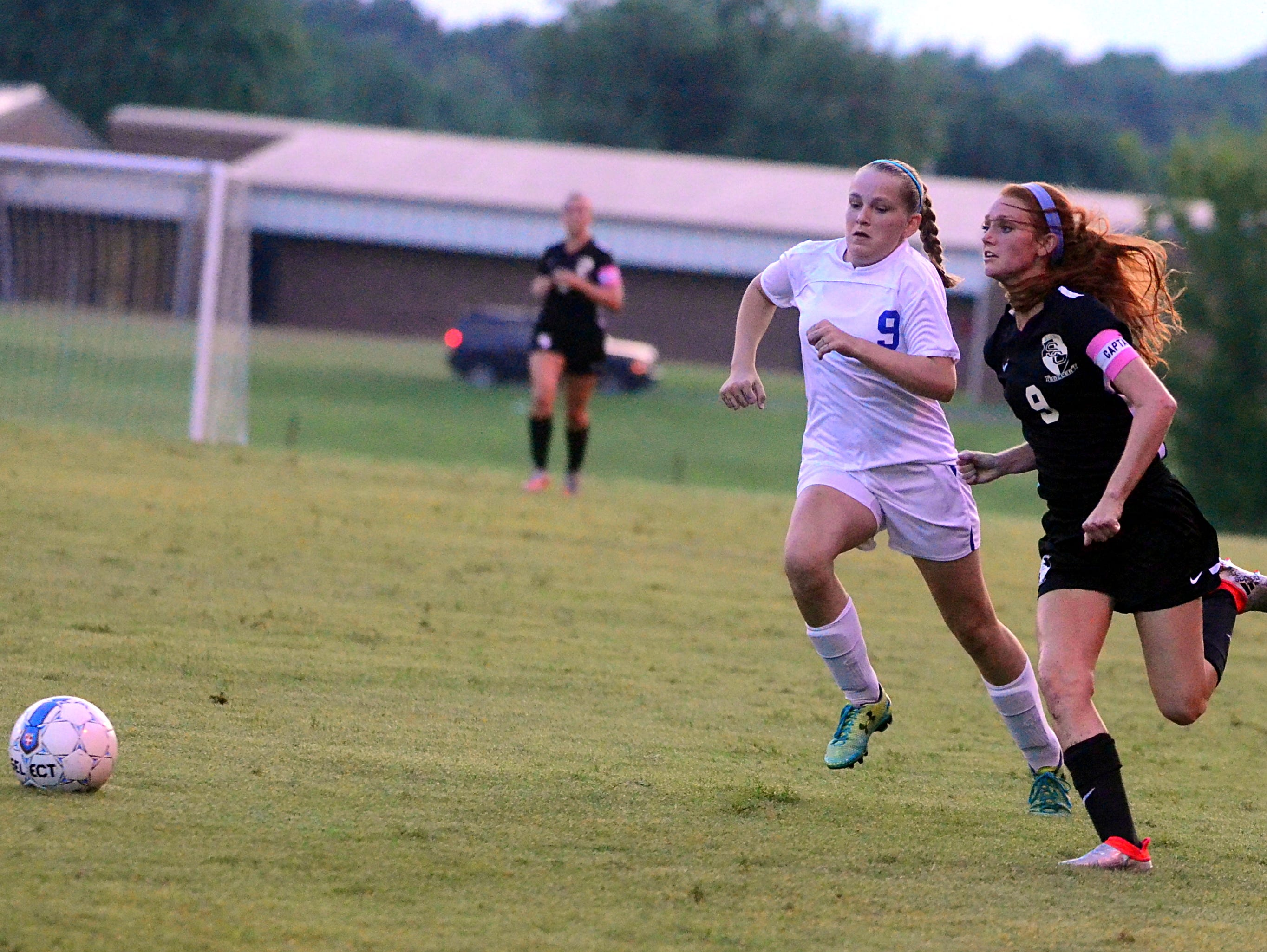 Station Camp High senior Megan Brinkley battles White House sophomore Haley Moran for a loose ball during first-half action. Brinkley had an assist in the Lady Bison's 5-0 victory.