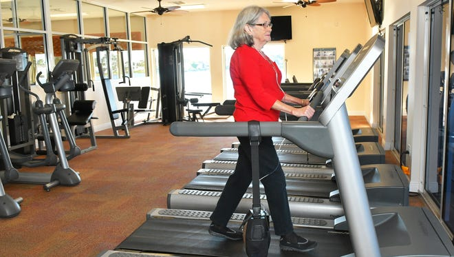 Karen Deitemeyer has COPD and is an advocate for public awareness of this medical condition. She is seen in photos at the Lamplighter Village clubhouse, where she can use a treadmill with her portable oxygen concentrator.