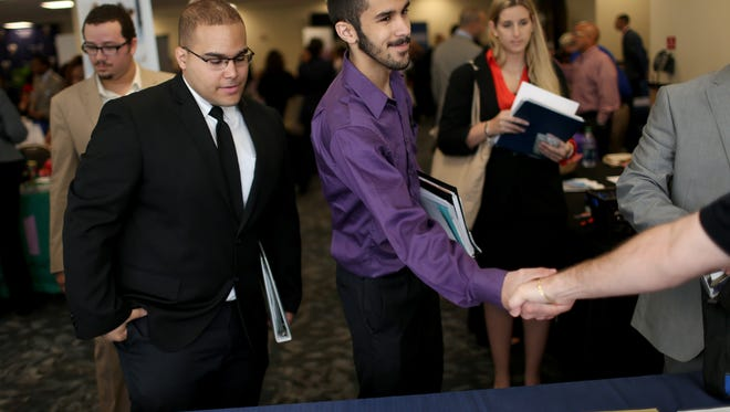 Economists believe job growth rebounded in February, fueling activity at career fairs like this one.