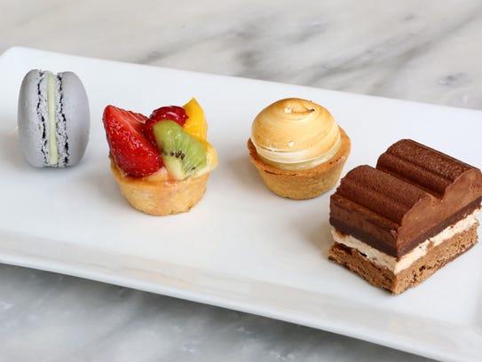 A macaron, fruit tart, lemon meringue and the Royal