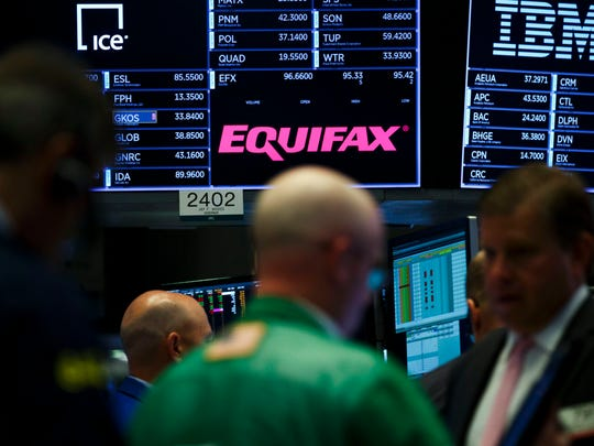 A view of a sign for the company Equifax on the floor of the New York Stock Exchange on 15 September 2017. The company recently disclosed that a data breach, discovered in July 2017, may have impacted as many as 143 million consumers in the United States. Equifax is one of the three main organizations in the US that calculates credit scores and has access to personal information including names, Social Security numbers, birth dates, addresses, some driver's license, and credit card numbers.