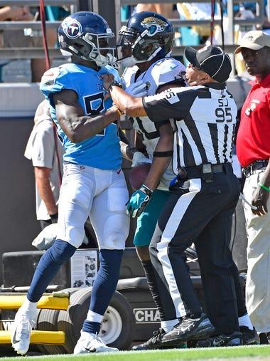 Titans wide receiver Corey Davis (84) and Jaguars cornerback