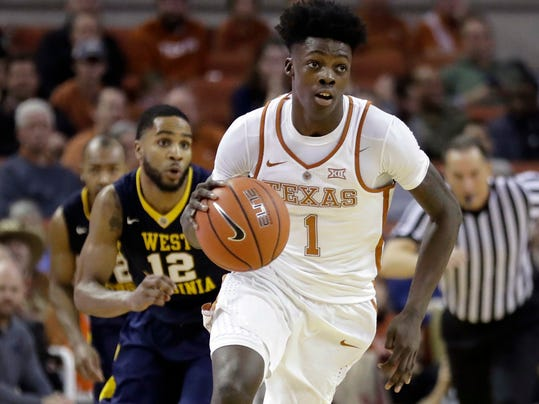 "FILE - In this Jan. 14, 2017, file photo, Texas guard Andrew Jones (1) brings the ball up court during the second half of an NCAA college basketball game against West Virginia in Austin, Texas. The announcement that Jones was diagnosed with leukemia prompted concern and well wishes from across college basketball. He is now starting to offer glimpses of how he's coping with his treatment, and sending ""thank you"" messages for the emotional and financial support that have poured in to help. (AP Photo/Eric Gay, File)"