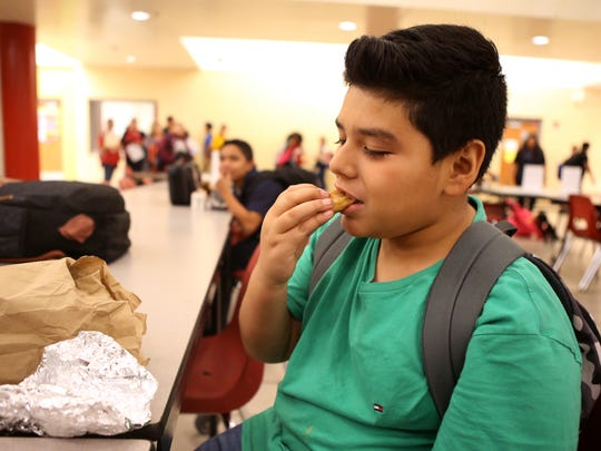 Seale Junior High School student Amaro Villarreal, 11, eats dinner at the school on Sept. 28, 2017. The Robstown Independent School District began an after-school dinner program this year that provides free meals for students.