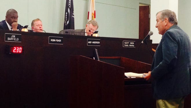 Melbourne Beach resident Dave Pasley addresses the Brevard County Commission. On the dias are, from left, Commissioners Robin Fisher and Andy Anderson, and Brevard County Attorney Scott Knox.