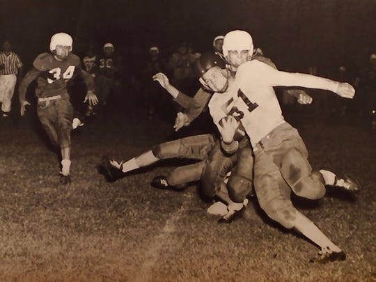 Before he was an Air Force pilot, Robert Hickman (51) was a star halfback for Bolton High School.