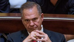 Alabama Chief Justice Roy Moore listens to closing