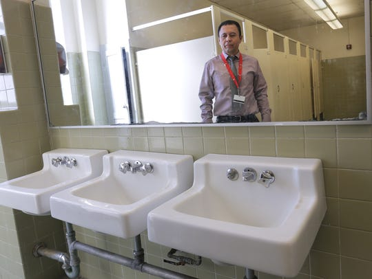 Jefferson High School Principal Fred Rojas is reflected