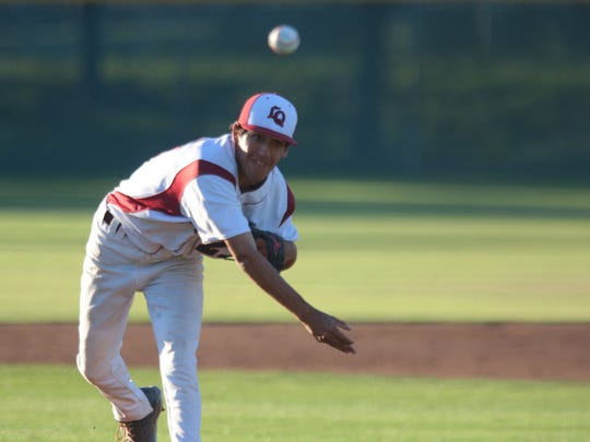 La Quinta's Jacob Mesa pitches against Xavier College Prep on Tuesday at La Quinta High School.