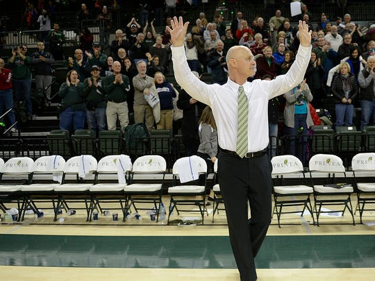 UW-Green Bay head coach Kevin Borseth acknowledges the crowd after winning his 600th game against Valparaiso during Thursday night's Horizon League game at the Kress Events Center in Green Bay. Evan Siegle/Press-Gazette Media