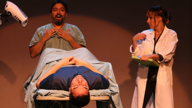 Armand Banooni (left) and Kandi Krumins (right) deal with Kyle Bushre in a scene from the Farmington Players production of Vast Differences.