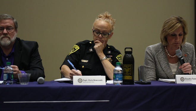 Broome County Sheriff's Capt. Kate Newcomb takes notes during an opioid and heroin community forum Tuesday at Binghamton University.