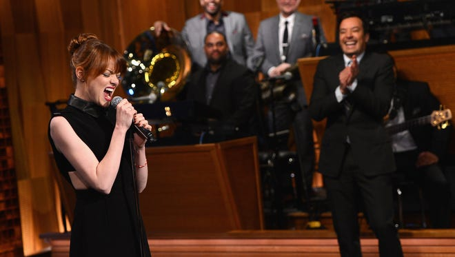 "Emma Stone and Jimmy Fallon have a ""Lip Sync Battle"" during a taping of ""The Tonight Show Starring Jimmy Fallon"" at Rockefeller Center on April 28, 2014 in New York City."
