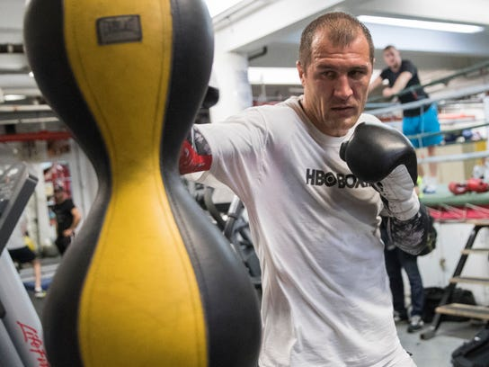 Sergey Kovalev hits a punching bag during a media workout at Mendez Gym, Tuesday, Feb. 27, 2018, in New York. Kovalev is scheduled to defend his WBO light heavyweight title against Igor Mikhalkin on Saturday, March 3, at the Theater at Madison Square Garden. (AP Photo/Mary Altaffer)
