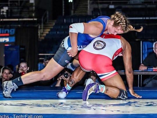 Sara Kouba, blue singlet, competes in the 172-pound