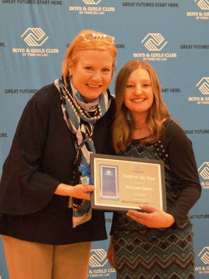 Maureen Toshner, vice president of human resources at Grande Cheese and board member for Boys & Girls Club of Fond du Lac, presents Autumn Smet, Boys & Girls Club of Fond du Lac's 2018 Youth of the Year, with her well-deserved award.