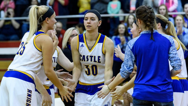 Castle's Jessica Nunge (30) receives high-fives from her teammates as she is introduced as a starter for the SIAC Tournament Championship last year. The Knights are 8-0 after a victory over Memorial on Saturday.