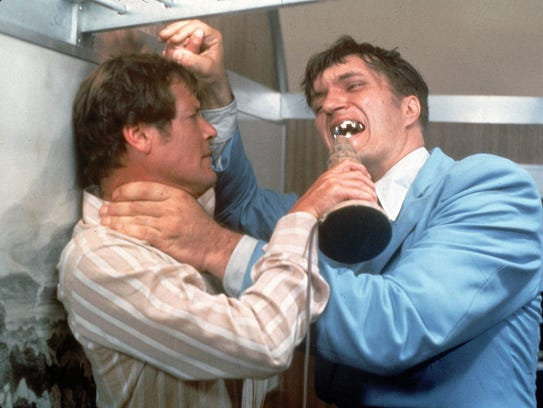 Bond (Roger Moore, left) tussles with Jaws (Richard