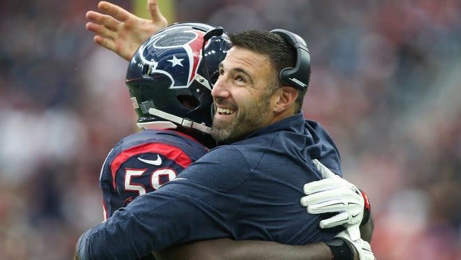 Houston Texans defensive coordinator Mike Vrabel became the first to interview for the Titans' vacant head coaching job Thursday.