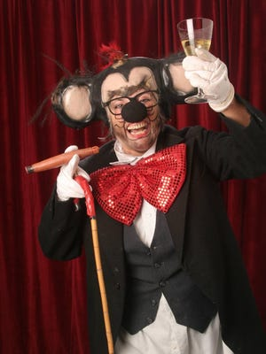 Pictured: Mickee Faust (played by Terry Galloway) is the foul-mouthed, cigar-chomping rodent ringleader of the Mickee Faust Club.