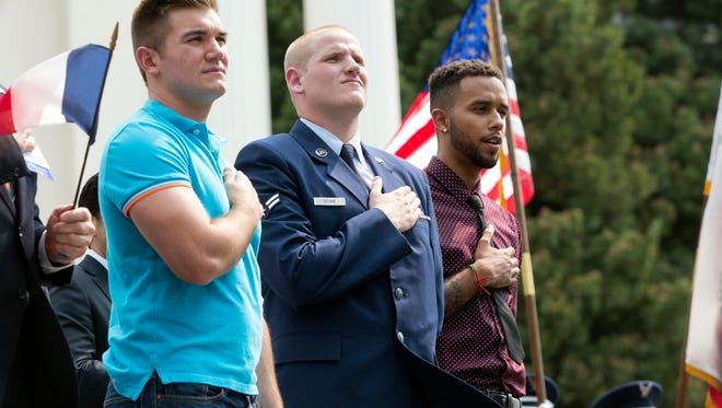 Oregon National Guardsman Alek Skarlatos, left, U.S. Airman Spencer Stone, center, and Anthony Sadler attend a parade held to honor the three Americans who stopped a gunman on a Paris-bound passenger train, in Sacramento, Calif.