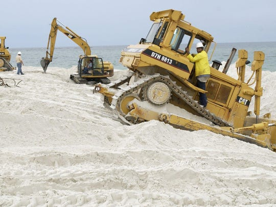 Weeks Marine crew members work on the 2005 Pensacola Beach renourishment project in this file photo. The Santa Rosa Island Authority selection committee will recommend Weeks Marine on Wednesday at the SRIA board meeting for the upcoming beach renourishment project.