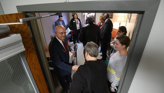 Richland County Prosecutor Gary Bishop greeted guests to the new victim witness lounge at the prosecutor's office before the ribbon cutting ceremony Friday morning.