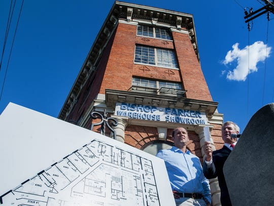 Montgomery Mayor Todd Strange, right, and hotel developer John Tampa, left, announce the development of a hotel in the old Bishop Parker building in Montgomery on Sept. 21.