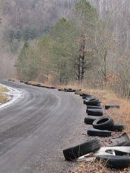 Originally reported as 62 tires found strewn along Tyson Road near the Muskingum and Coshocton county line ended up being 128 tires when those found on an adjacent road and over an embankment were added in. Dep. Kevin Cichon, litter prevention officer for the Coshocton County Sheriff's Office, said he is continuing to investigate the case with assistance from the Muskingum County Sheriff's Office and Ohio Department of Natural Resources.