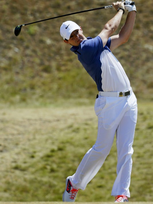 Rory McIlroy ruptured a ligament in his left ankle while playing soccer and will not participate in the British Open.