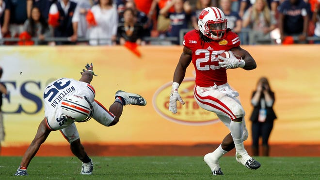 Jan 1, 2015: Wisconsin Badgers running back Melvin Gordon (25) runs with the ball against the Auburn Tigers during the second half in the 2015 Outback Bowl at Raymond James Stadium. Wisconsin Badgers defeated the Auburn Tigers 34-31 in overtime.