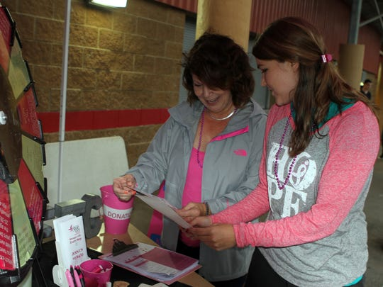 Breast cancer survivor Mary Ann Leath (left) was one