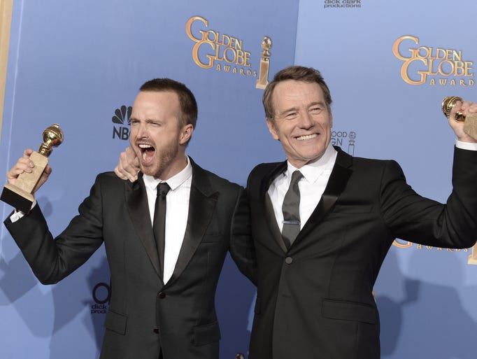 BEVERLY HILLS, CA - JANUARY 12:  Actors Aaron Paul (L) and Bryan Cranston, winners of Best Series ? Drama for 'Breaking Bad,' pose in the press room during the 71st Annual Golden Globe Awards held at The Beverly Hilton Hotel on January 12, 2014 in Beverly Hills, California.  (Photo by Kevin Winter/Getty Images)