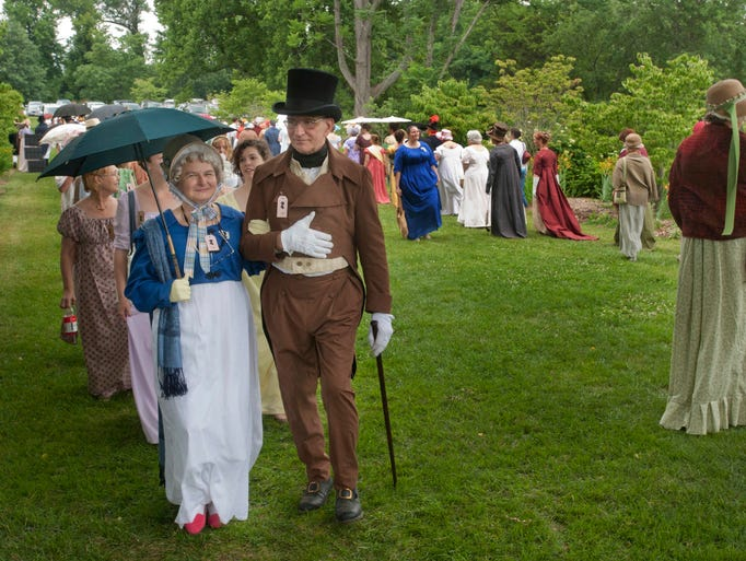 Mrs. Rebecca Osborne and her husband, Capt. William Osborne of Whitewater, Wisc., march in the Promenade at the Jane Austen Festival at Locust Grove. Bonny Wise, the regional coordinator for the Jane Austen Society said she believes the event set a new record for the number of people in regency attire with an unofficial count of 491individuals participating in the promenade. 19 July 2014
