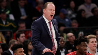 Wisconsin head coach Greg Gard instructs his players during their Sweet 16 game against Florida.
