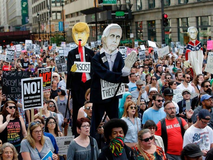 Demonstrators carry effigies of President Donald Trump